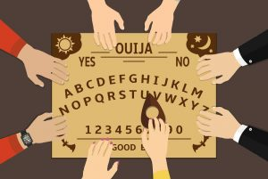 Ouija board playing